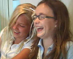 Two happy students using video